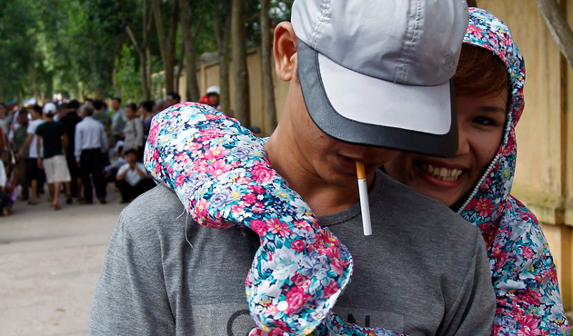 A former inmate (L) is greeted by his relative after he is released from Hoang Tien prison, about 100 km (62 miles) outside Hanoi August 30, 2013.