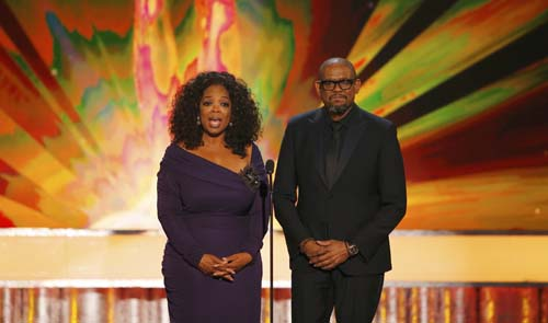 Larger than life Oprah celebrating 60th birthday quietly at home