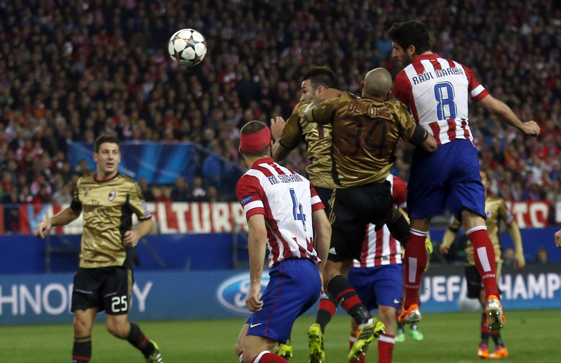 Atletico humble Milan to clinch last-eight spot