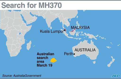 Australia says expanded search area for Flight MH370 may take a year