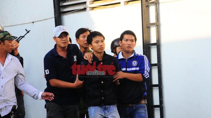 Vietnam gunman nabbed after firing 50 shots at police