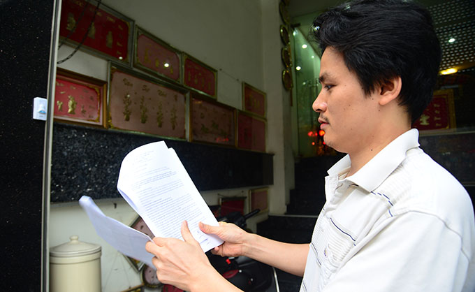 Vietnam man files complaint against $18,800 fine for purportedly buying $100