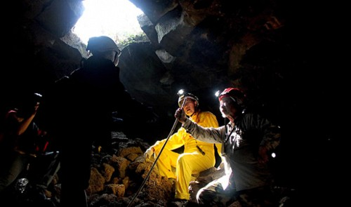 Dr. H. Tachihara (right) and T. Honda (middle)- two veteran experts of the Japan Caving Association expedition team. The two have explored volcanic caves in Hawaii, South Africa and elsewhere in the world.