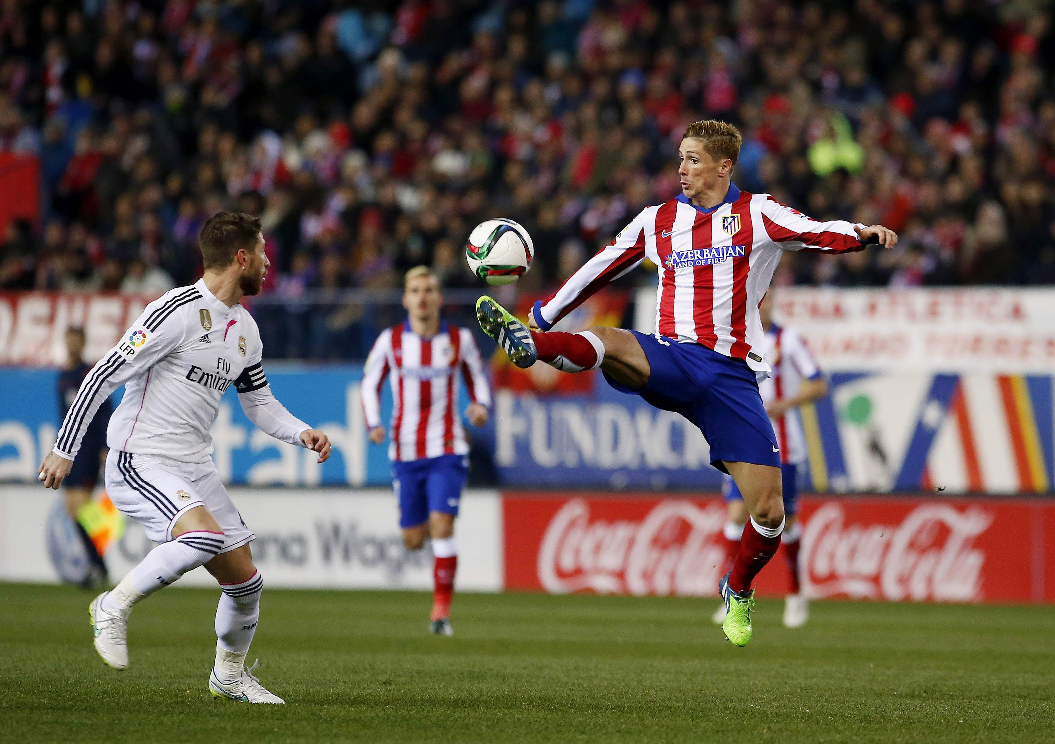 Torres subdued on return but Atletico sink Real