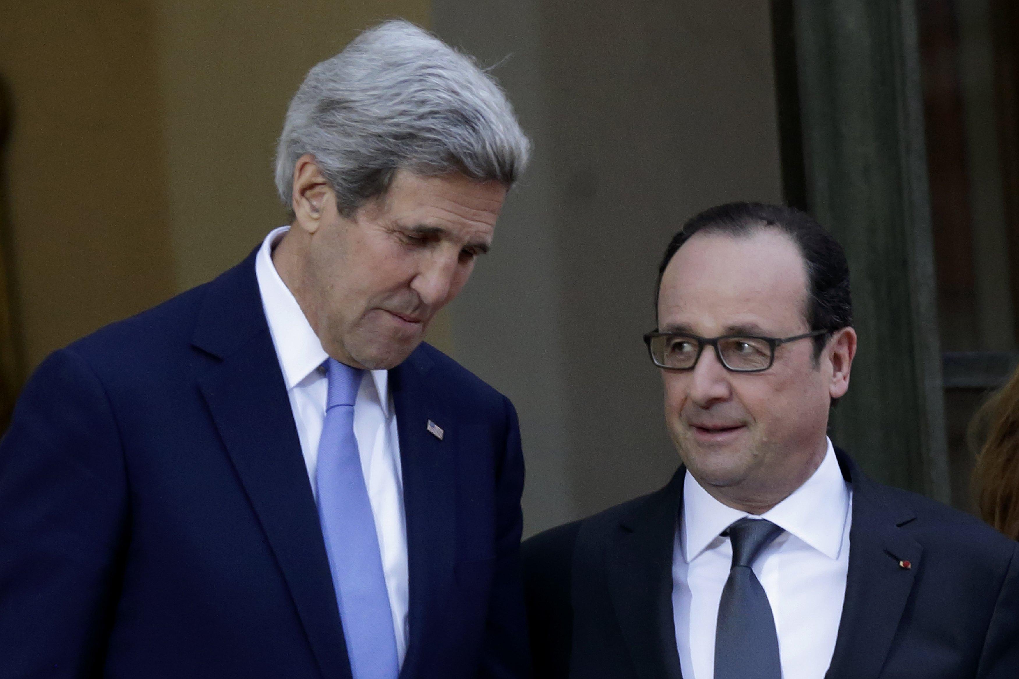 Paris police arrest 12 linked to shootings as US' Kerry arrives