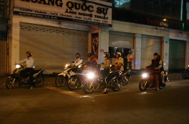 A motorcyclist is pictured trespassing the zebra crossing at 9.51 pm on January 25, 2015 while waiting at the red lights at District 3's Huynh Van Banh- Tran Huy Lieu intersection. None of his fellow drivers followed suit.