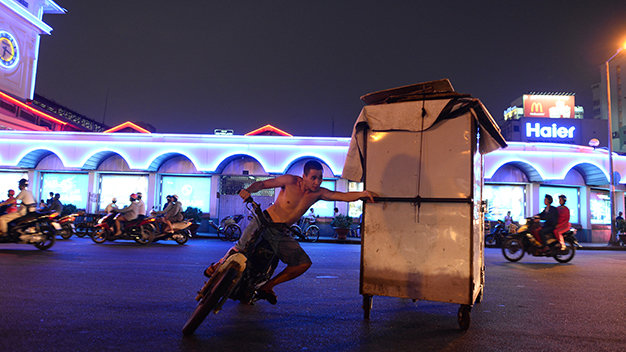 Stall owners and staffers defy traffic laws in pushing or pulling along bulky items and not wearing helmets to cut down preparation time.