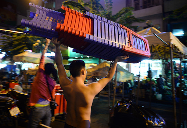 Muscular young men are hired to set up stalls for around VND3 million (US$140) a month.