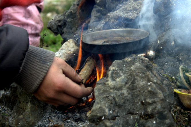 The fire is strong enough for the youngsters to cook a dish and get some warmth from in the chilly weather.