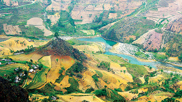 Nho Que River both serves as a tourist attraction and Mong ethnic people's main water supply.