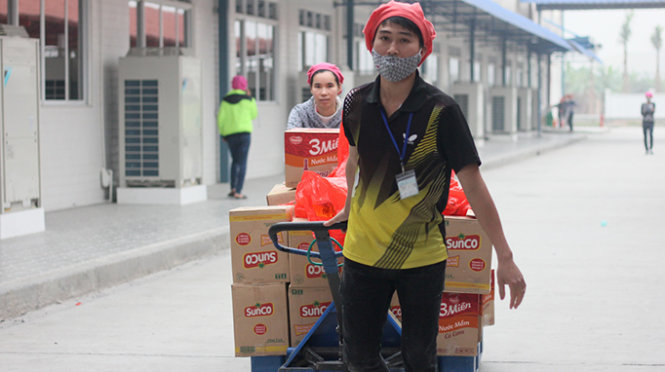 In Vietnam, thousands of workers return Tet gifts over fake product doubt