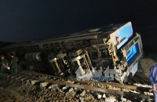 Train hits truck, throwing three carriages off railway, killing engine driver in Vietnam