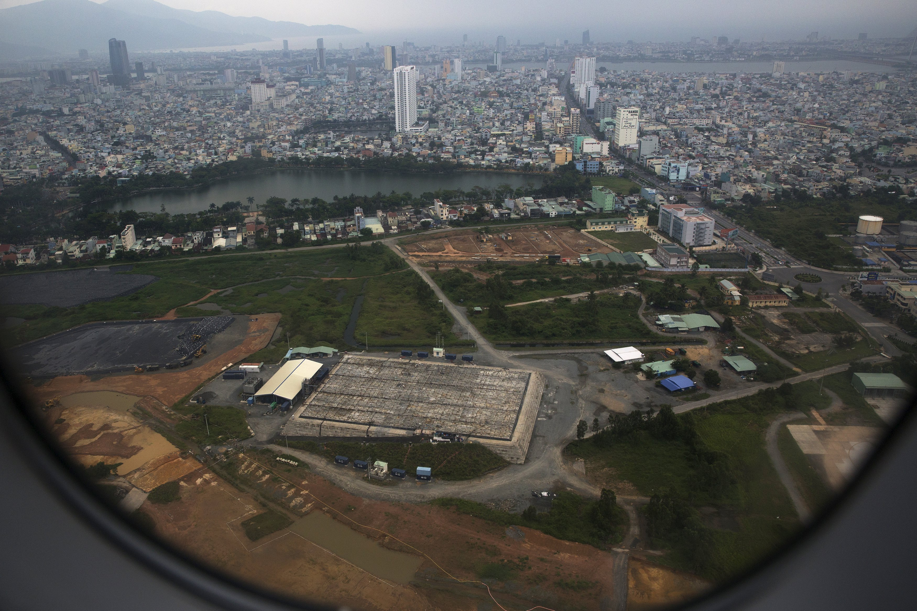 The cleaning operation of the area that was used for storing Agent Orange is seen from a plane taking off from Danang international airport April 13, 2015. Agent Orange was stored at Danang airbase and sprayed from U.S. warplanes to expose Vietnamese troops from the North and destroy their supplies, in jungles along the border with Laos. Since 2012, both the U.S. and Vietnam have been conducting a clean-up operation at the site.
