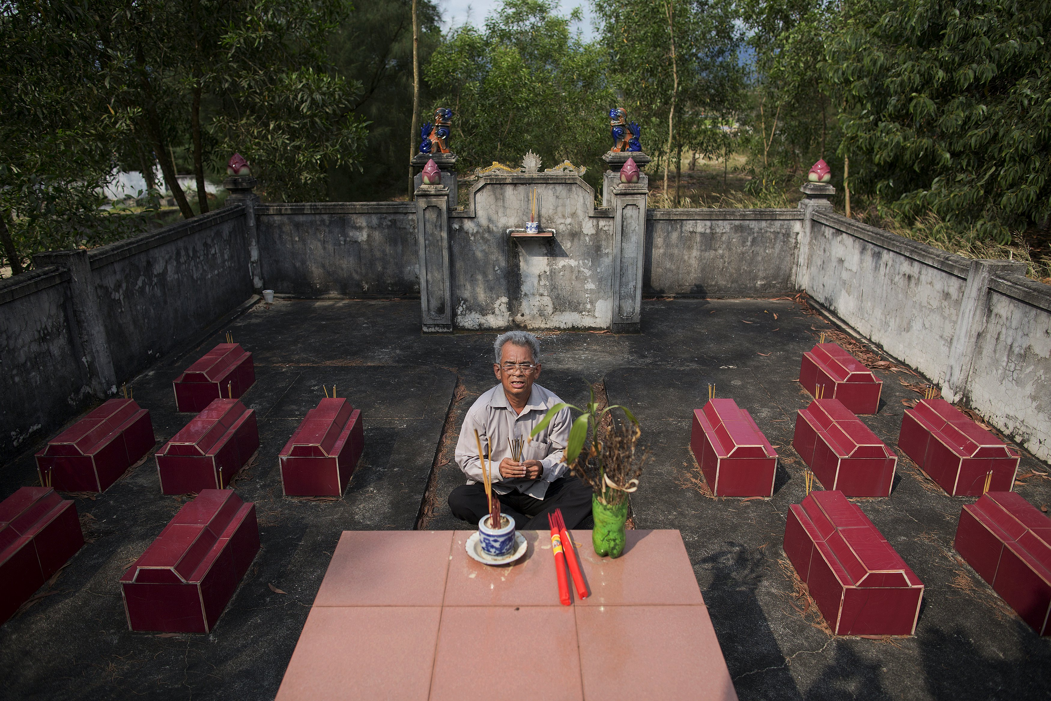 Former soldier Do Duc Diu prays at the cemetery where twelve of his children are buried, after showing the graves to reporters, near his house in Quang Binh Province in central Vietnam April 11, 2015. Twelve of his fifteen children died from illnesses that the family and their doctors link to Do Duc Diu's exposure to Agent Orange. Do Duc Diu served as a Vietnamese soldier from the North in the early 70s in areas that were heavily contaminated by Agent Orange. He only found out about the possible dangers of Agent Orange before his last child was born in 1994. He said that if he had known about the possible effects of Agent Orange he would not have had children. Before he found out about the effects of Agent Orange, Do Duc Diu said that he and his wife visited many spiritual leaders and prayed at different shrines as they attributed their children's sickness to their ill-fated destiny.