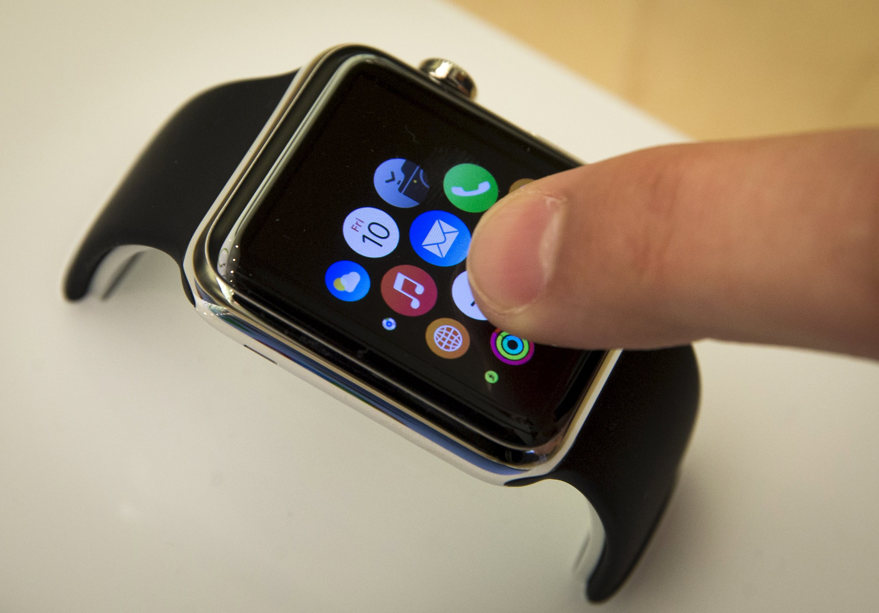 Apple tests smartwatch market with quiet debut of Cook's first product