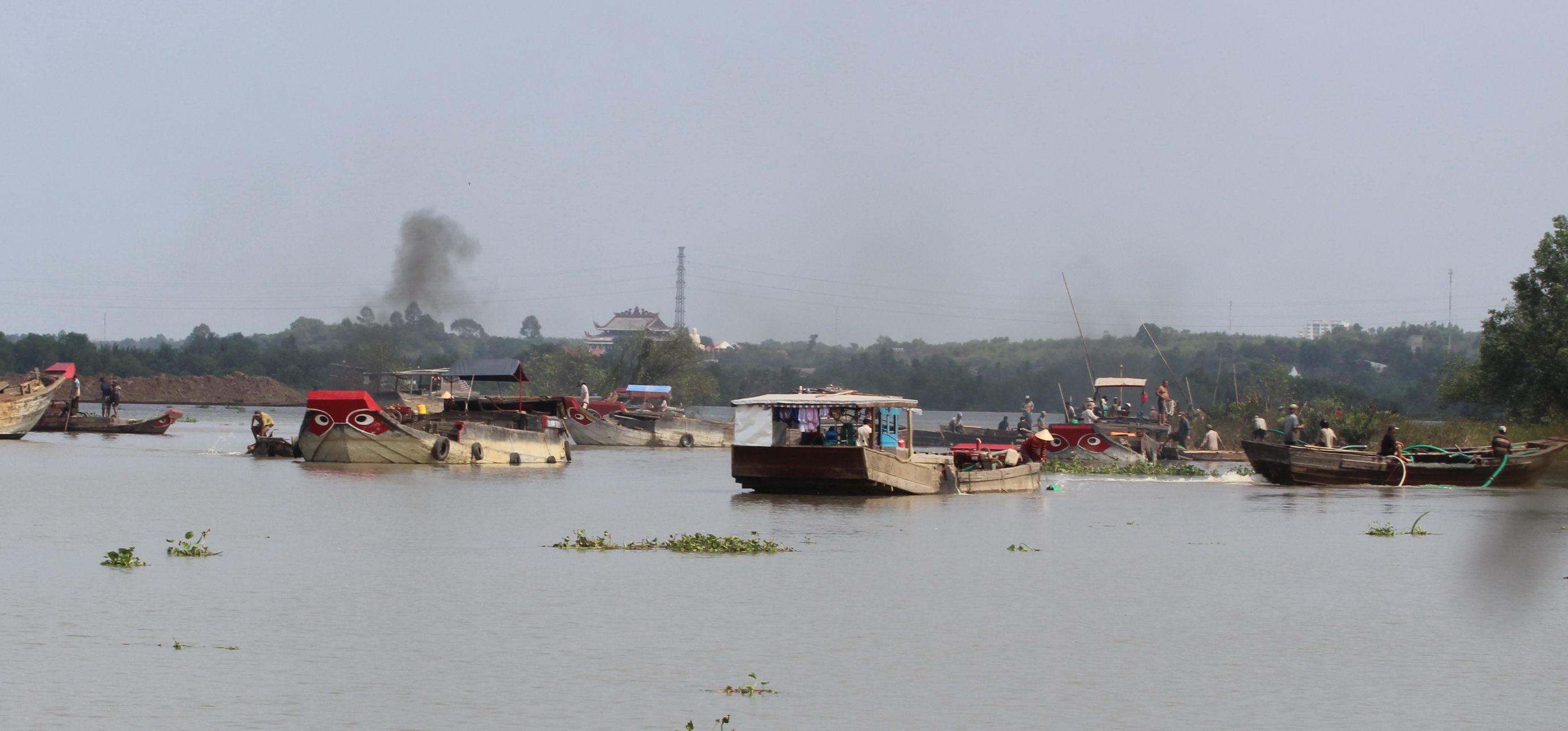 Dozens of sampans and large boats riddle an area which used to be locals' land.