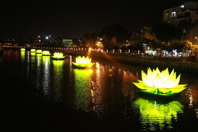 Lighted lotuses glitter on Saigon's revived canal in celebration of Vesak