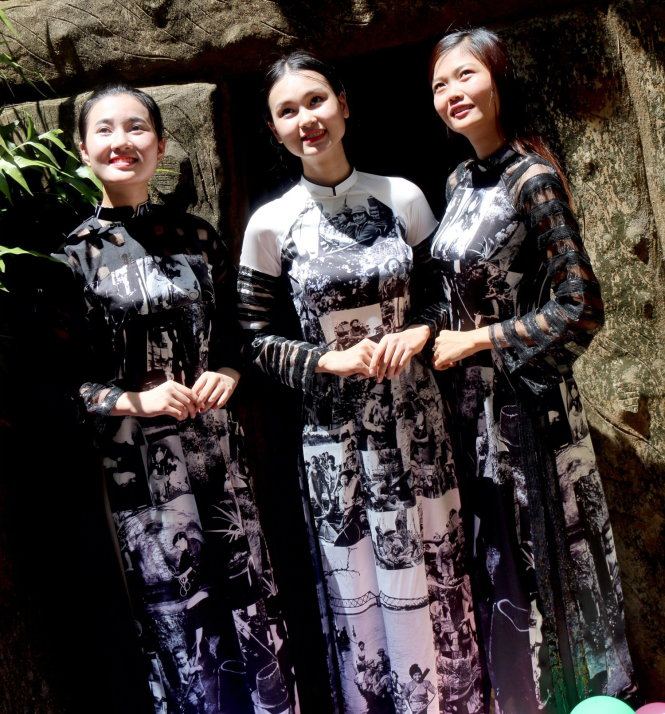 'Ao dai' featuring wartime images displayed at exhibit in Vietnam tunnel