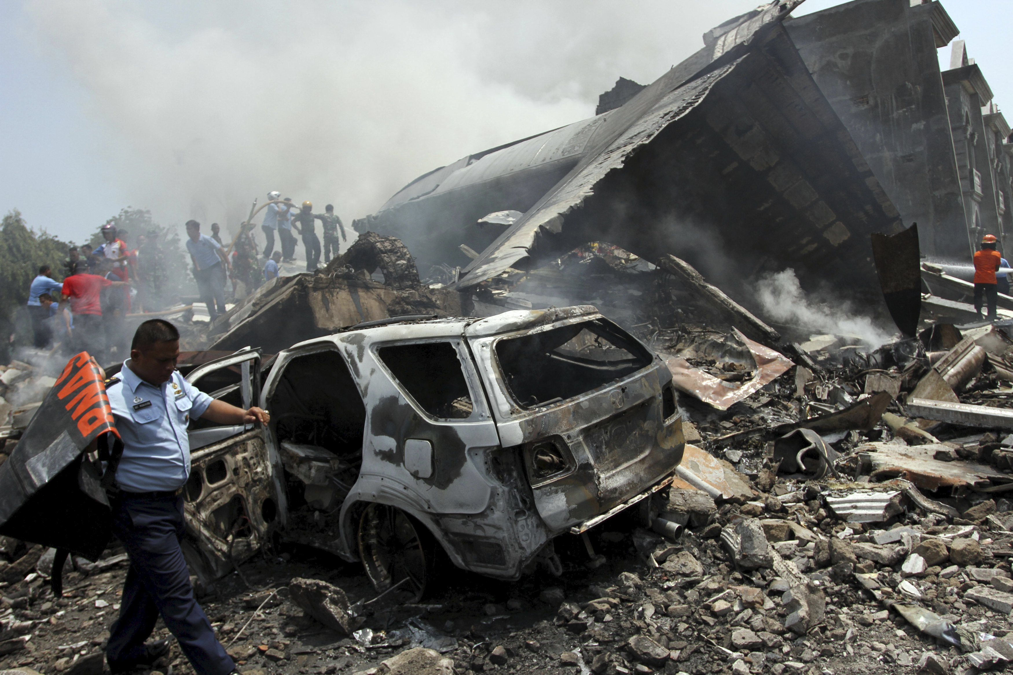 Over 100 feared dead after Indonesia military plane crashes