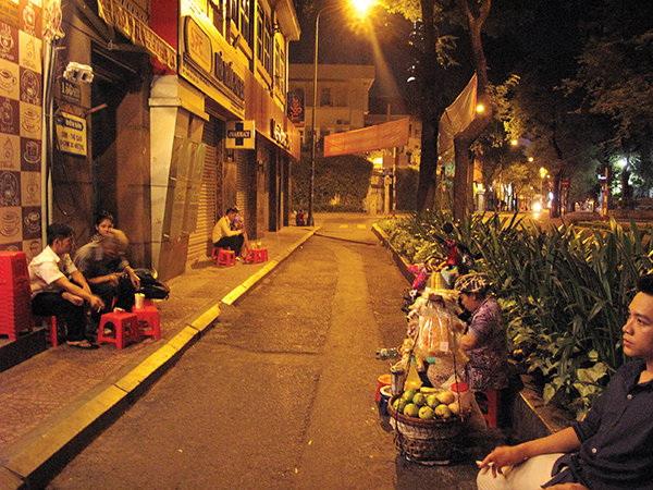 Around-the-clock cafés offer glimpses of Saigon by night