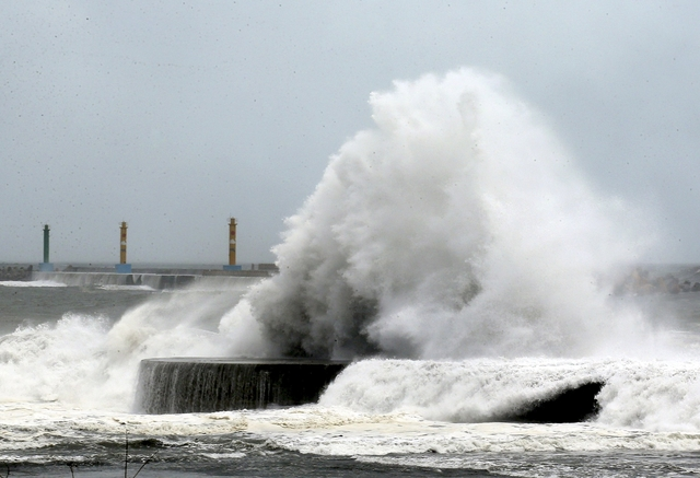 Big storm hits Taiwan, millions without power, two dead