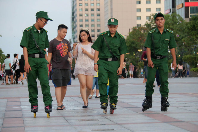 Security guards skate for faster patrol in downtown Ho Chi Minh City