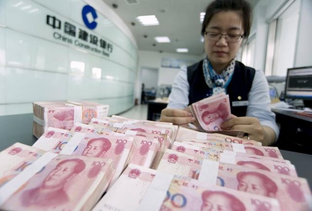 China tries to calm currency war fears as yuan slips further