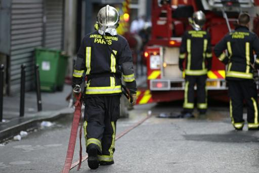 Eight dead in apartment fire in north Paris: police