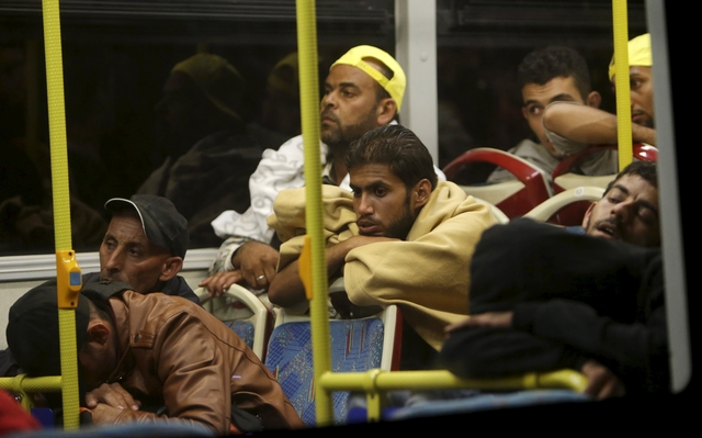 Migrants enter Austria, swept west by overwhelmed Hungary