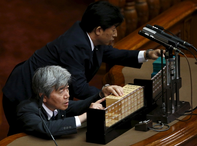 Japan enacts bills easing pacifist constitution's limits on military