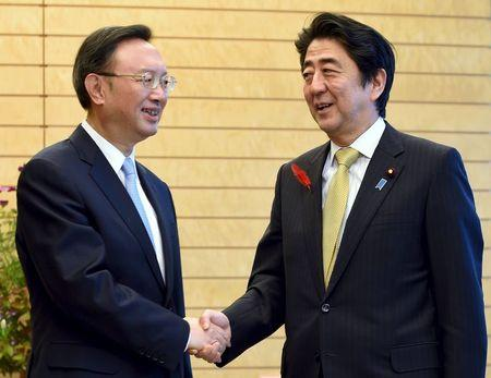 Japan, China vow to keep up ties, despite Nanjing row, spying arrests