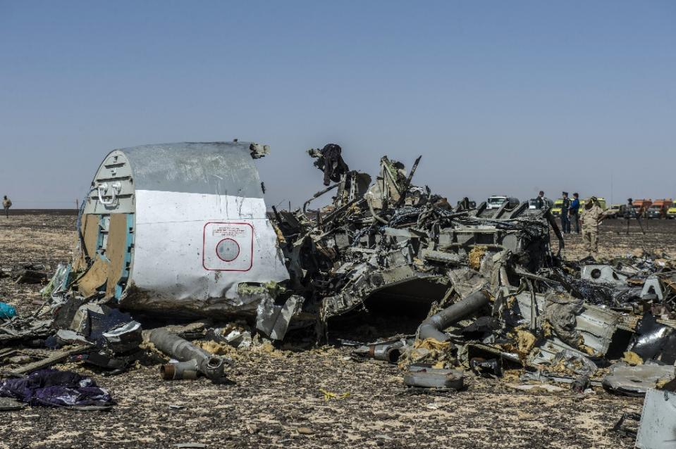 Russia plane 'broke up in air', bodies flown home from Egypt
