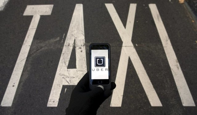 Taxi owners, lenders sue New York City over Uber