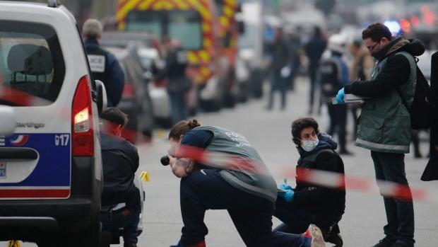 Gunfire erupts in Paris as police swoop on suspected mastermind