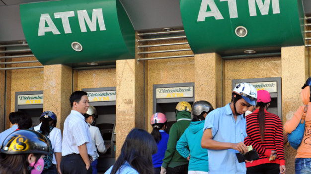 In about-face, Vietnam's Vietcombank resumes ATM service, money transfer for foreigners