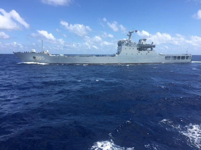 Chinese warship soldiers point guns at Vietnamese supply boat in Vietnam's waters