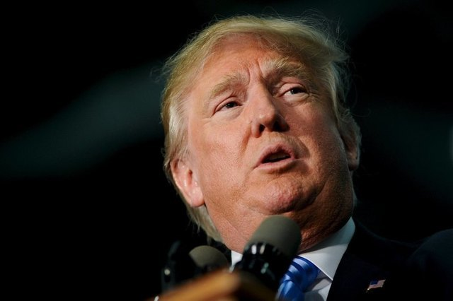Trump defends proposed Muslim ban from U.S. as outrage mounts