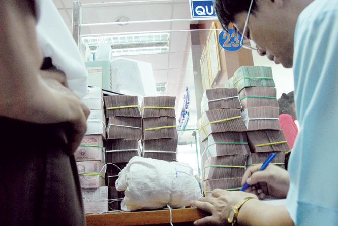 Vietnam to announce central rate for dong/dollar daily: central bank