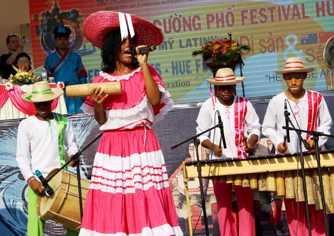 Changó, a band from Colombia, performs at the street festival.