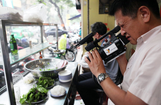 A cameraman is seen filming the dish.