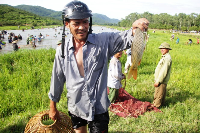 A man catches a carp at the festival.