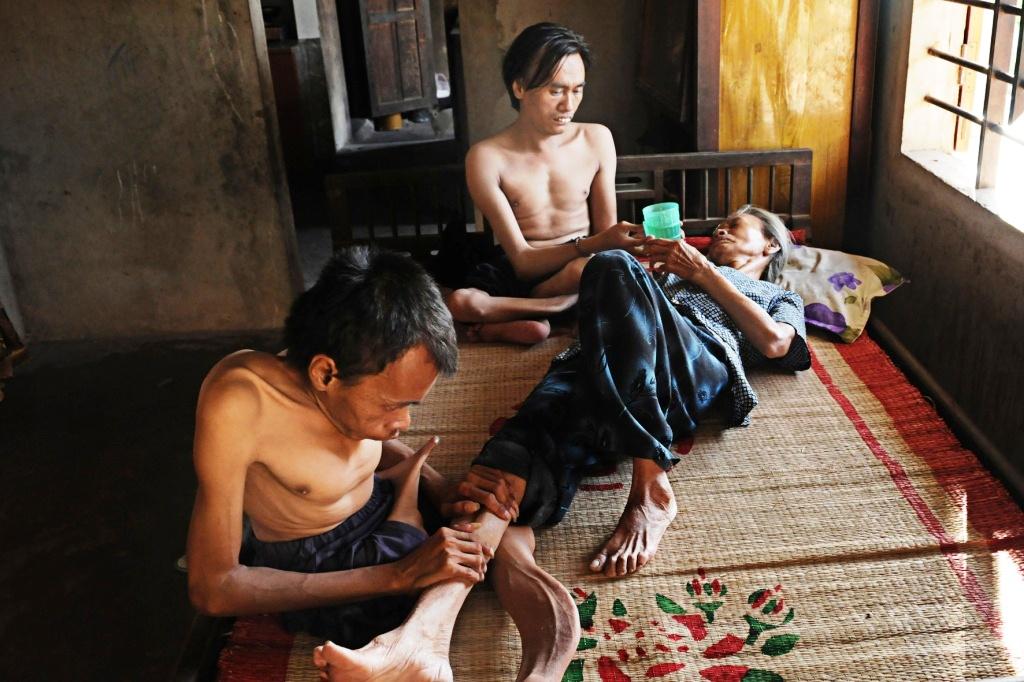Nguyen Van Hai and Nguyen Van Hien look after their mother when she gets sick.