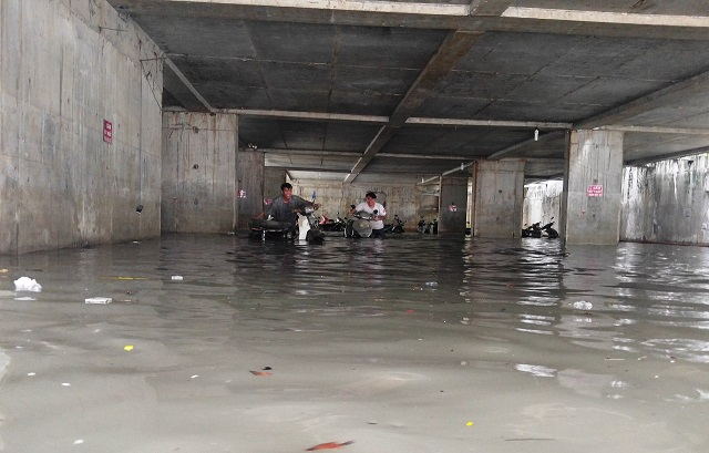 Issues emerge as heavy storms flood parking basements in Ho Chi Minh City