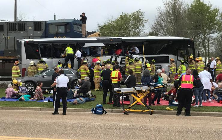 Four killed when freight train hits bus in Mississippi
