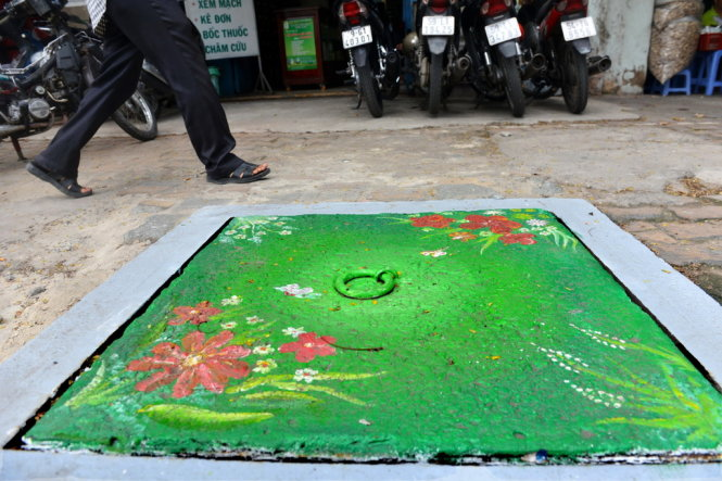 Painted manhole covers in Saigon hoped to increase environmental awareness