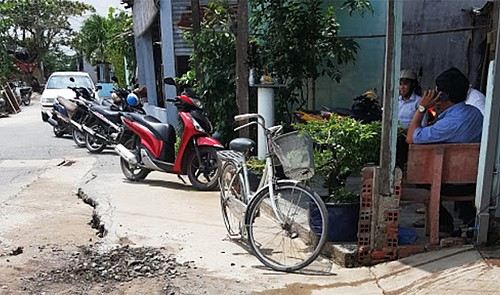 Road cracks pose threat of subsidence in Ho Chi Minh City's suburban district