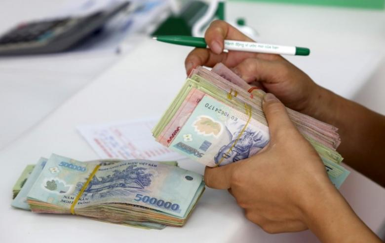 Vietnam's central bank defends surprise rate cuts amid credit worries