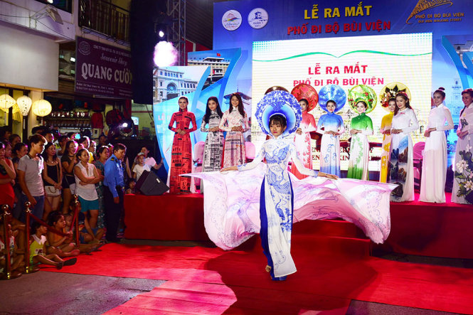Models are seen during an ao dai show.