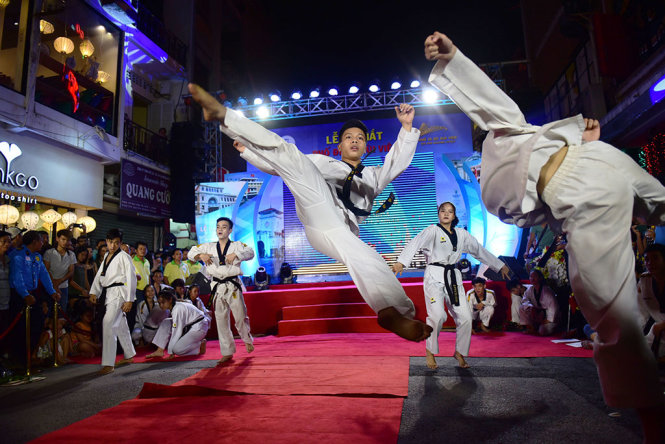 A team of martial artists is seen during performance