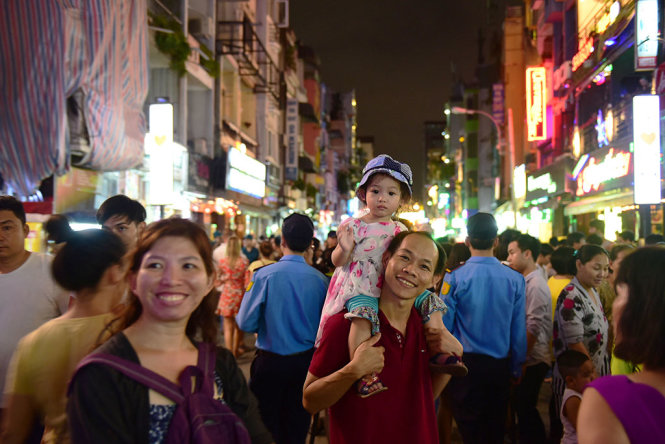Locals are seen at the Bui Vien Walking Street.